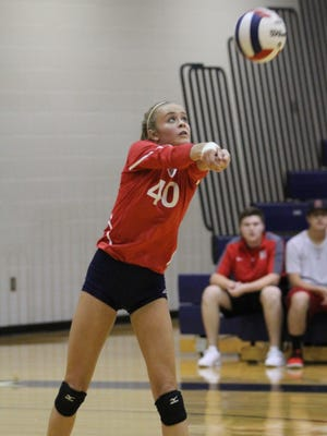 Lila Branlund returns a serve Tuesday in Heritage's 3-2 win over Greenbrier.