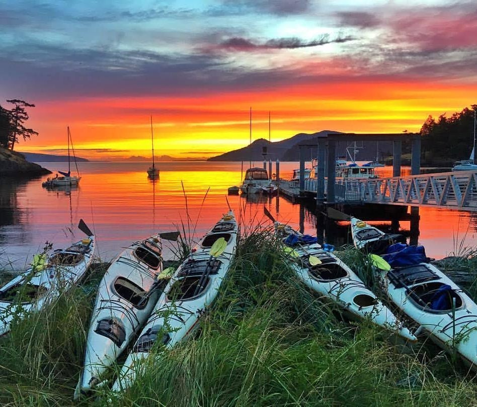 Travelers can explore the border's western stretch on a multi-day sea kayaking trip in Washington state's San Juan Islands.