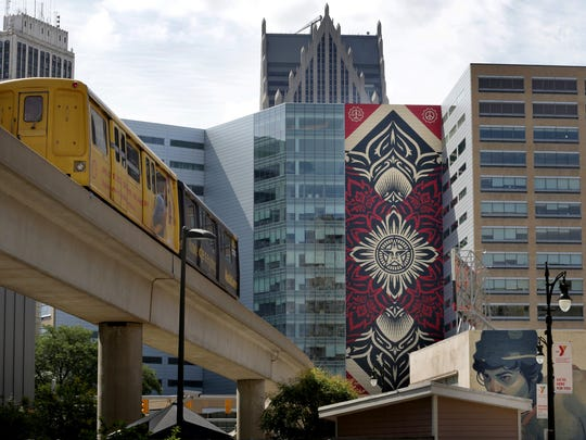 A Shepard Fairey mural commissioned by Dan Gilbert and painted on the One Campus Martius building.