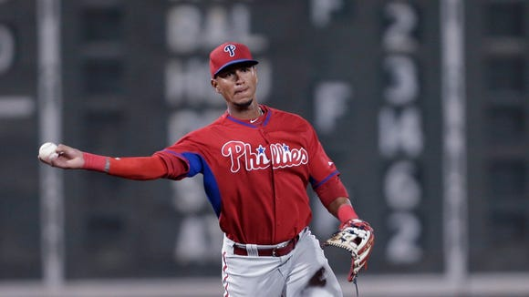 Philadelphia Phillies shortstop Ronny Cedeno throws out Boston Red Sox Matty Johnson on a groundnut in the ninth inning of an exhibition baseball game in Fort Myers, Fla., Saturday, March 15, 2014. (AP Photo/Gerald Herbert)
