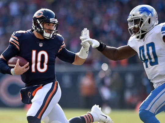 CHICAGO, IL - NOVEMBER 11:  Quarterback Mitchell Trubisky #10 of the Chicago Bears carries the football against Jarrad Davis #40 of the Detroit Lions in the second quarter at Soldier Field on November 11, 2018 in Chicago, Illinois.  (Photo by Quinn Harris/Getty Images)