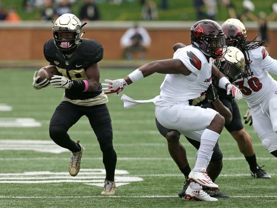 Wake Forest's Greg Dortch (89) breaks free after a catch against Louisville during the first half of an NCAA college football game in Winston-Salem, N.C., Saturday, Oct. 28, 2017. (AP Photo/Chuck Burton)