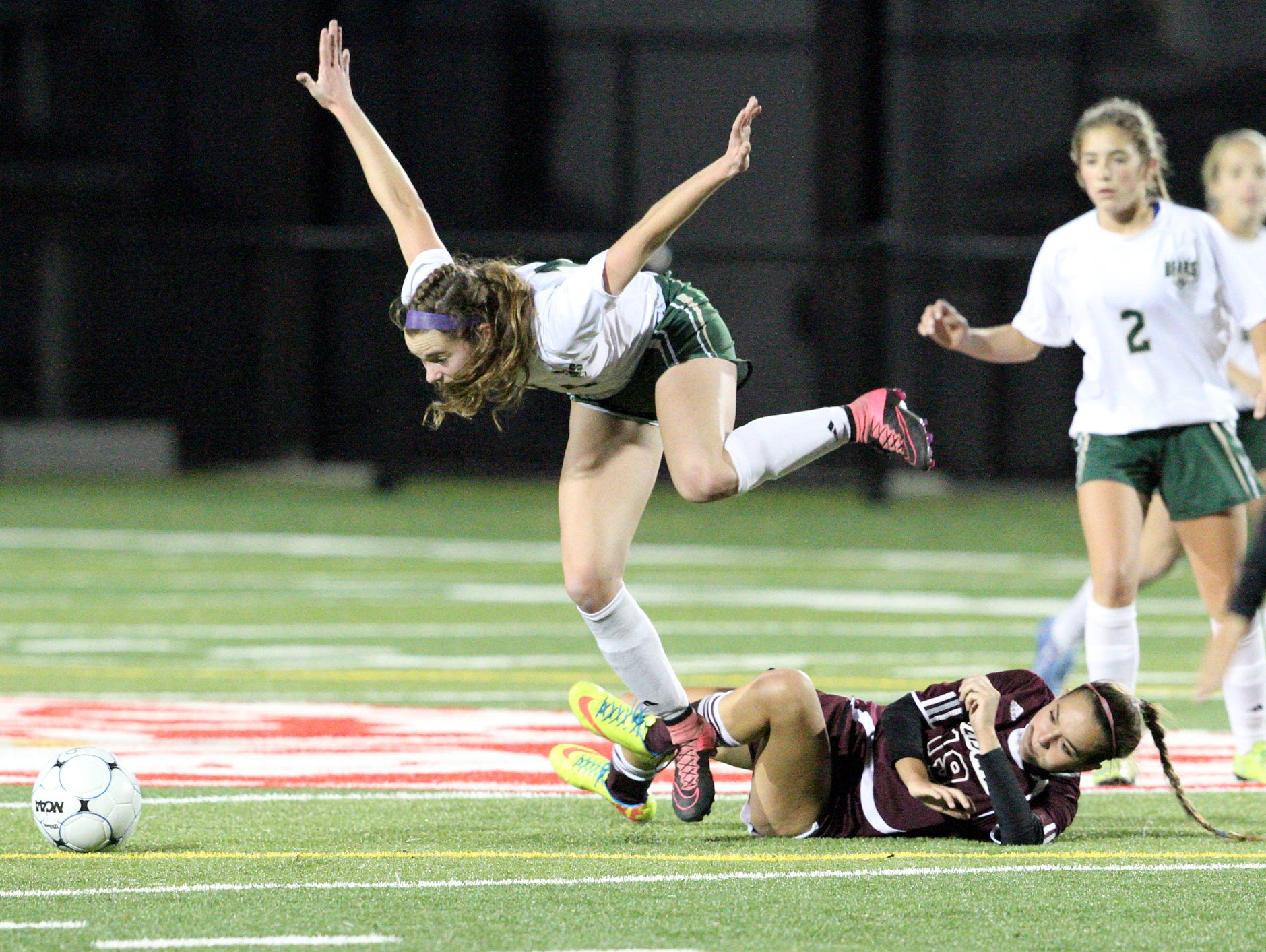 Vestal's Madeline Beaulieu leaps over Johnson City's Brittany Carpenter Friday during the Section 4 Class A final.