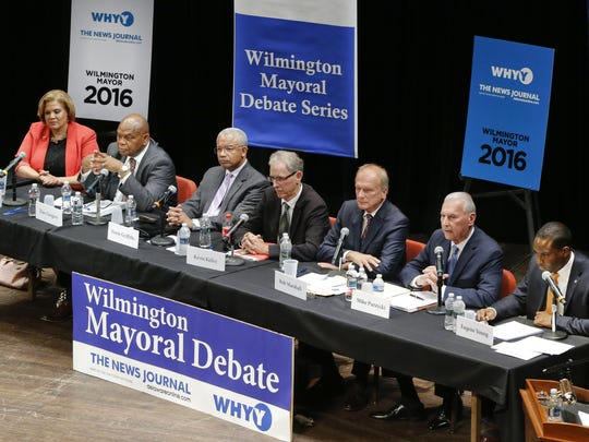 Wilmington mayoral candidates (from left) Maria Cabrera, Theo Gregory, Norm Griffiths, Kevin Kelley, Bob Marshall, Mike Purzycki and Eugene Young take part in a debate at the Grand Opera House on May 26. Incumbent Mayor Dennis P. Williams has not taken part in any debate hosted by The News Journal and WHYY.