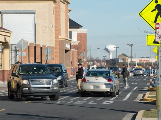 Vehicles in front of the Walmart located in the Westown Town Center in Middletown.
