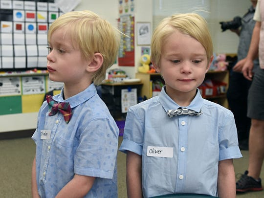 First day kindergarteners Fennley, left, and Oliver Siri stand in their classroom on his first day of Kindergarten at Jesse Hall Elementary on Monday August 14, 2017.