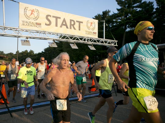Wausau Marathon runners take off from the starting line at Marathon Park in Wausau, Saturday, Aug. 22, 2015.