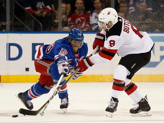 636436250803490488-Devils-Rangers-Hockey-njha-7-.jpg