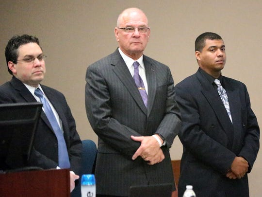 Devon Huerta-Person, right, stands with his attorneys, Adolfo Quijano Jr., center, and Omar Carmona as the jury enters 384th District Court in February.