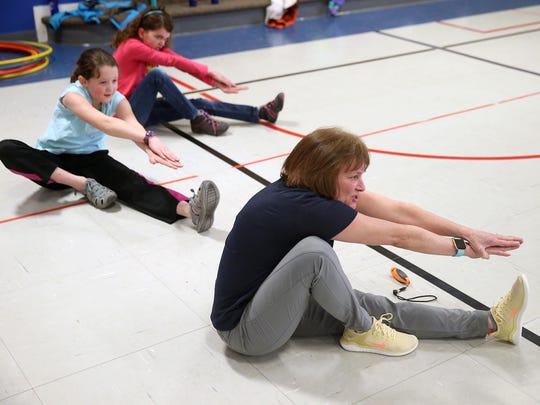 Cheryl Chase, a South Colby Elementary physical education instructor, leads a class in exercises.