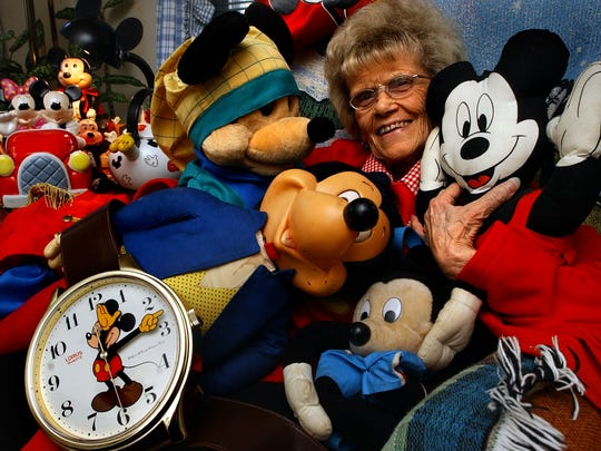 Gloria 'Mickey' Kauffman with part of her collection of Mickey Mouse at her home in Manchester Township in 2003.