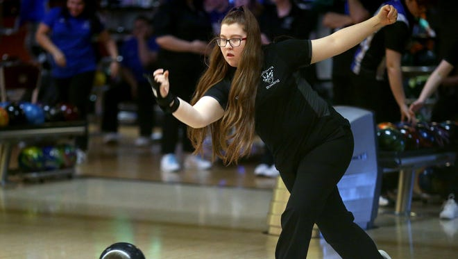 Klahowya Secondary School team bowling captain Briana Kennard rolls at All-Star Lanes in Silverdale on Thursday.