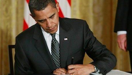President Obama signs legislation.