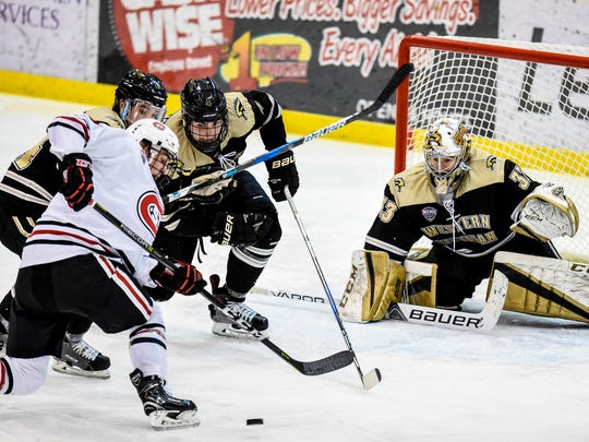 St. Cloud State's Jack Poehling has his shot on goal blocked against Western Michigan last year at the Herb Brooks National Hockey Center.