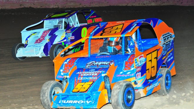 Michael Burrows (55) leads Richie Hitzler during the Modifieds race at Linda's Speedway last Friday night. Burrows won a tight race over Hitzler.