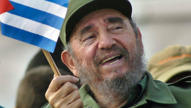 Cuban then President Fidel Castro waving a national flag during a May Day ceremony at Revolution Square in Havana, Cuba, in 2005.