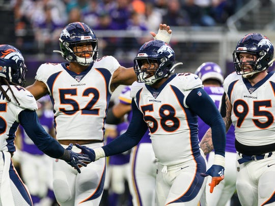 MINNEAPOLIS, MN - NOVEMBER 17: Von Miller #58 of the Denver Broncos celebrates after sacking Kirk Cousins #8 of the Minnesota Vikings in the first quarter of the game at U.S. Bank Stadium on November 17, 2019 in Minneapolis, Minnesota. (Photo by Stephen Maturen/Getty Images)