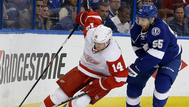 Detroit Red Wings center Gustav Nyquist, left, and Tampa Bay Lightning defenseman Braydon Coburn vie for control of the puck during the first period of Game 2 on Friday, April 15, 2016, in Tampa.