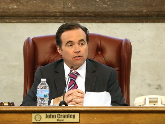 Cincinnati Mayor John Cranley along with members of