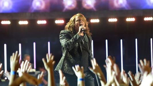 Caleb Johnson performs at the American Idol finale.