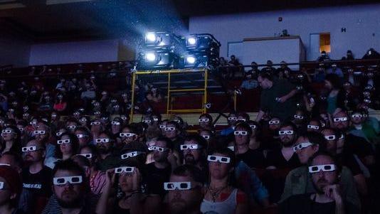 Fans watch Kraftwerk's 3D performance during Moogfest 2014.
