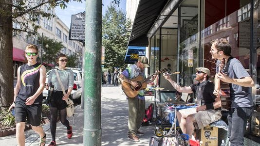Musicians perform downtown.