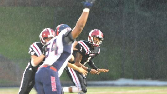 Asheville High quarterback Tevin Salters (1) watches a pass sail on Friday.