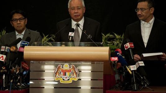 Malaysian Prime Minister Najib Razak delivers a statement on the missing Malaysia Airlines flight MG370 during a press conference in Kuala Lumpur on Monday.