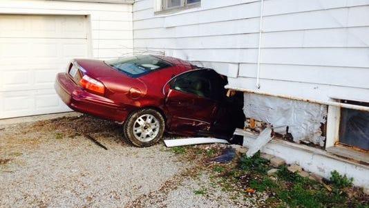 Stolen car crashed into Union Township home on Thursday.