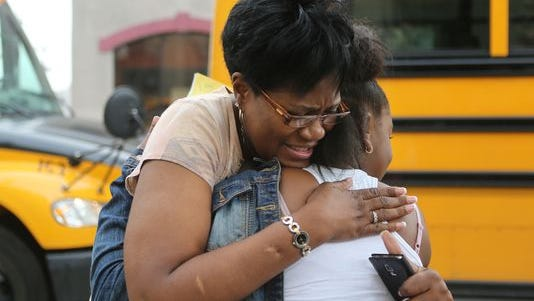 Superintendent Valerie Lee says goodbye to sixth-grader Essence Lee on the last day of school at VLT Academy on May 29.