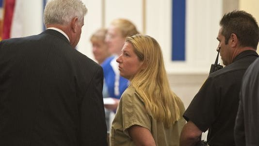 Julie Hautzenroeder is led out of the courtroom by an officer after her bail was set on July 31, 2013. Colerain High School teacher Julie Hautzenroeder, 36, was arrested by Hamilton County sheriff's deputies on July 30 for having sex with two students.