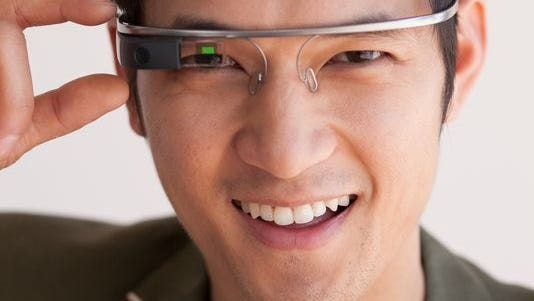 Actor Harry Shum, Jr. with his Google Glass. Google Glass is a wearable computer with an optical head-mounted display (OHMD) which displays information in a smartphone-like hands-free format.