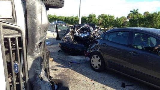 A four-vehicle crash shut down the eastbound lanes on the Midpoint Bridge between Cape Coral and Fort Myers on Tuesday.