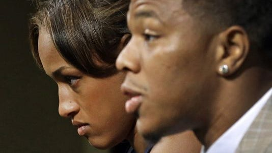 FILE - In this May 23, 2014, file photo, Janay Rice, left, looks on as her husband, Baltimore Ravens running back Ray Rice, speaks to the media during an news conference in Owings Mills, Md. Rice starts his two-game suspension Saturday, Aug. 30, 2014, missing the Ravensí home opener against Cincinnati and a key AFC North showdown in Pittsburgh.
