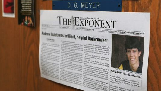 A clipping from the Exponent about Andrew Boldt hangs on the door of professor David Meyer's office in the Materials and Electrical Engineering Building. The newspaper is now suing the university over withheld surveillance footage.