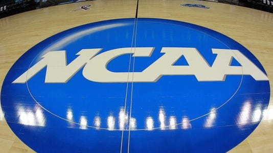 FILE - NCAA logo on the floor of the Final Four court.