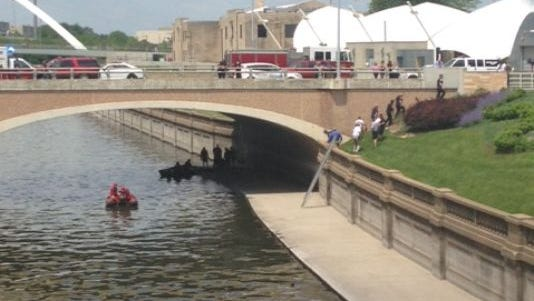 The Des Moines Fire Department's wet team recovers a body from the Des Moines River downtown.