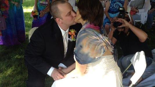 Mindi Jo Flanagan and Joe Bakalar share a moment at their wedding Saturday evening in Des Moines.