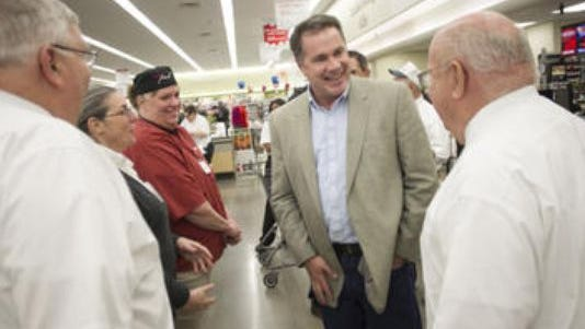 U.S. Rep. Bruce Braley chats with Hy-Vee employees and military veterans in Iowa City on April 17, 2014 during a photo opportunity meant to bring awareness to the Hire a Hero Act.