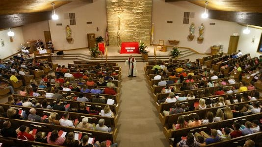 Community members gather for a prayer service Monday, Aug. 4, 2014, at St. John the Baptist Catholic Church in Peosta. The service was held for four boys who died Saturday in a crash south of Epworth.