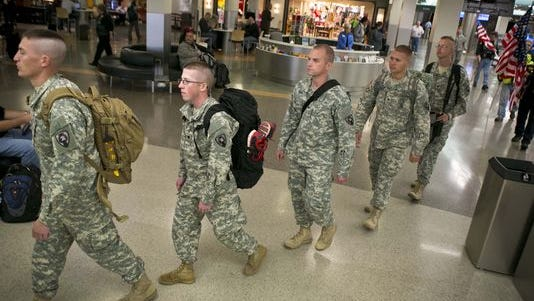 Members of the 186th Military Police Company, Iowa Army National Guard, arrive home last year at the Des Moines airport after serving in Honduras. Approximately 40 soldiers were mobilized from the company based at Camp Dodge in Johnston in December 2012. They conducted and supported joint and inter-agency operations, including countering transnational organized crime and humanitarian assistance/disaster relief.