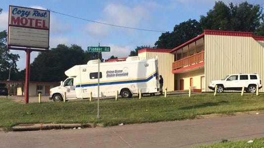 Police investigate an officer-involved shooting at the Cozy Rest Motel.