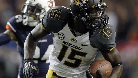 Missouri wide receiver Dorial Green-Beckham (15) runs for a touchdown pass against Auburn (24) during the second quarter of the 2013 SEC Championship.