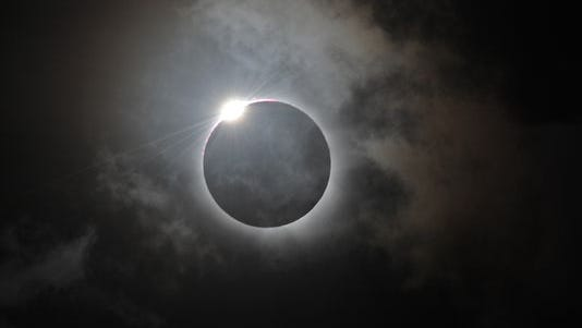 The Diamond Ring effect is shown following totality of the solar eclipse on Nov. 14, 2012, at Palm Cove, Australia.