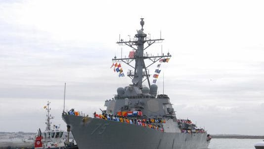 The Arleigh Burke-class guided missile destroyer USS Donald Cook arrives at Naval Station Rota, Spain, on Feb. 11, 2014.