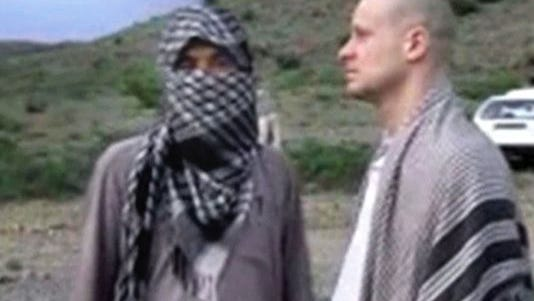 In this file image taken from video obtained from Voice Of Jihad website, which has been authenticated based on its contents and other AP reporting, Sgt. Bowe Bergdahl, right, stands with a Taliban fighter in eastern Afghanistan.