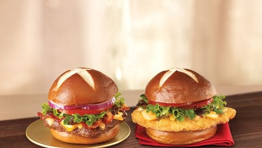 The Pretzel Bacon Cheeseburger and Pretzel Pub Chicken Sandwich are both returning to restaurants by the weekend of July 4,