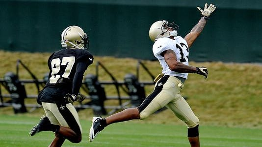New Orleans Saints wide receiver Joe Morgan (13) reaches for the ball in front of cornerback Champ Bailey (27) during NFL football training camp in White Sulphur Springs, W.Va., Sunday, July 27, 2014.