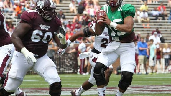 Jamaal Clayborn blocks for quarterback Dak Prescott during Mississippi State's spring game.
