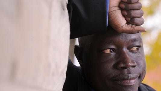 Abraham Madit Majak is the president of the Rescue South Sudan Village People group and is one of the Lost Boys from Sudan. Picture taken in Lansing Thursday October 2, 2014.